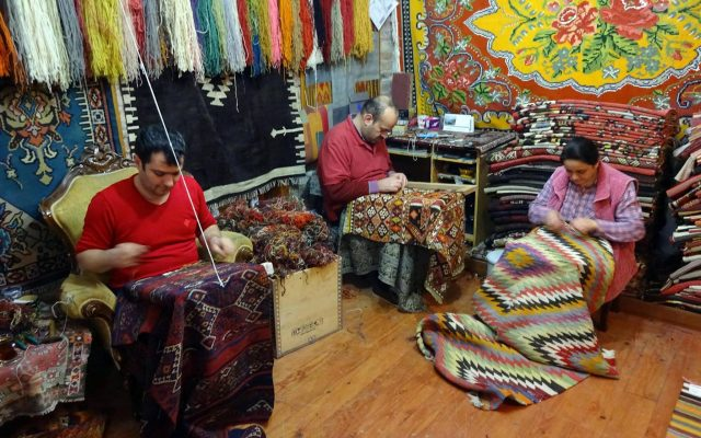 workers of carpet culture making rugs